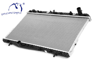 What is the function of a car radiator?